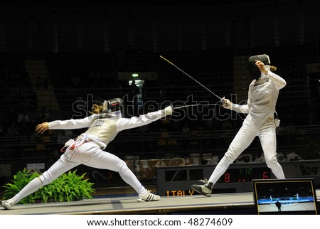 TURIN - FEB 7: Women Foil World Cup,  Valentina Vezzali fight team tournament final match Italy vs Russia on February 7, 2010 in Turin, Italy.