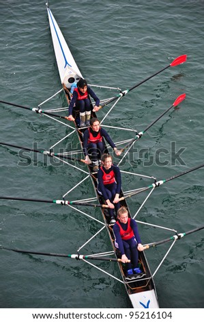 """TURIN - FEBRUARY 12: River Po, an unidentified crew during the traditional International long distance rowing regatta """"D'inverno sul Po"""" on February 12, 2012 Turin, Italy. - stock photo"""