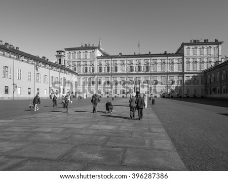 TURIN, ITALY - CIRCA MARCH 2016: Tourists visiting Palazzo Reale meaning Royal Palace in black and white