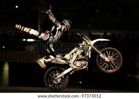 TURIN, ITALY - FEB 03: Remi Bizoaurd (FRA) performs trick during the 2012 FIM Mx Freestyle World Championship on February 03, 2012 in Turin, Italy. - stock photo
