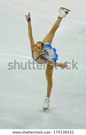 TURIN, ITALY - FEBRUARY 22, 2006: Carolina Kostner (Italy) performs during the Winter Olympics female's competition of the Figure Ice Skating. - stock photo