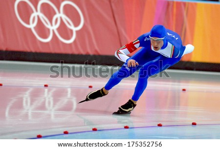 TURIN, ITALY-FEBRUARY 25, 2006: Italian Enrico Fabris competes on the Speed Ice Skating competition during the Winter Olympic Games of Turin 2006.