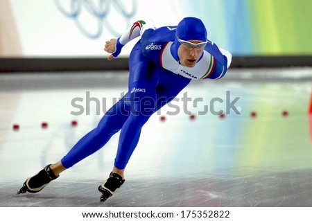 TURIN, ITALY-FEBRUARY 12, 2006: Italian Enrico Fabris competes on the Speed Ice Skating competition during the Winter Olympic Games of Turin 2006.