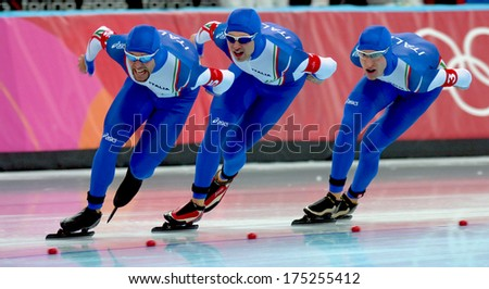 TURIN, ITALY FEBRUARY 17, 2006: Italian team competing during the Speed Ice Skating competition during the Winter Olympic games of Turin 2006.