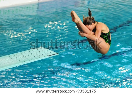 TURIN, ITALY - JANUARY 22: Francesca Dallapè competes at 1m diving board at 2012 Indoor diving italian championship on January 22, 2012 in Turin, Italy. - stock photo