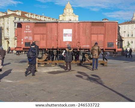 TURIN, ITALY - JANUARY 23, 2015: People visiting an holocaust train for deportation of Jews to concentration forced labour and extermination camps to mark the Primo Levi exhibition in Piazza Castello