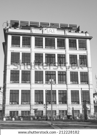 TURIN, ITALY - JANUARY 24, 2014: The Fiat Lingotto car factory designed by Trucco in 1916 was the largest car factory at the time and still houses the Fiat directional centre and an exhibition complex - stock photo