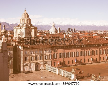 TURIN, ITALY - JANUARY 24, 2014: Tourists visiting Piazza Castello, the central baroque square vintage