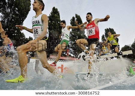 TURIN, ITALY - JULY 28: Competitors of 3000m Steeplechase Man Round of the Turin 2015 Italian Athletics Championships at the Primo Nebiolo Stadium on July 28, 2015 in Turin, Italy
