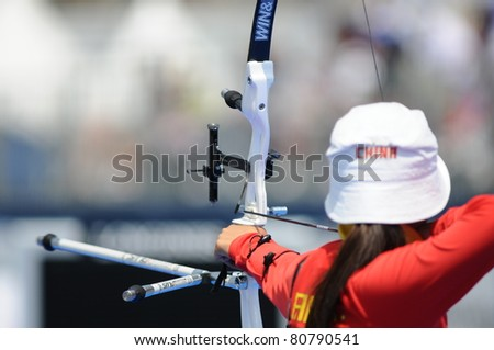 TURIN, ITALY - JULY 10: FANG Yuting (CHN) competes at round for bronze at women recurve 2011 World Archery and Para Archery Championships , on June 10, 2011 in Turin, Italy. - stock photo