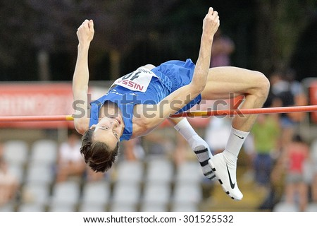 TURIN, ITALY - JULY 26: Marco Fassinotti perform high jump during Turin 2015 Italian Athletics Championships at the Primo Nebiolo Stadium on July 26, 2015 in Turin, Italy - stock photo