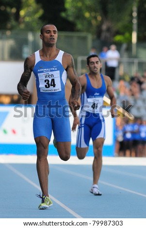 TURIN, ITALY - JUNE 26: Andrew Howe, the 2011 Italian champion, runs at 200m mens sprint race during the 2011 Summer Track and Field Italian Championship meeting on June 26, 2011 in Turin, Italy. - stock photo