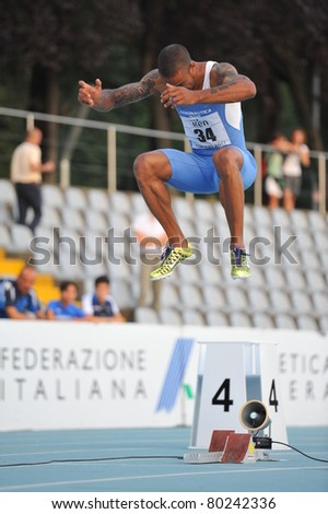 TURIN, ITALY - JUNE 26: Andrew Howe, the 2011 Italian champion, warms up before 200m mens sprint during the 2011 Summer Track and Field Italian Championship meeting on June 26, 2011 in Turin, Italy. - stock photo
