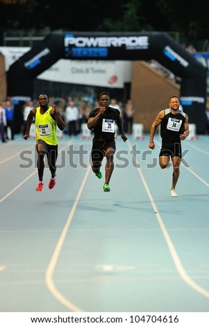 TURIN, ITALY - JUNE 08: Dwight Chambers (26) Su Sanneh (32) G�©rard Kob�©an�© (34) run 100m during the International Track & Field meeting Memorial Nebiolo 2012 on June 08, 2012 in Turin, Italy. - stock photo