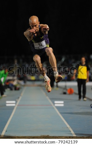 TURIN, ITALY - JUNE 10: Halevi Yochai (ISR) performs triple jump during the 2011 Memorial Primo Nebiolo track and field athletics international meeting, on June 10, 2011 in Turin, Italy. - stock photo