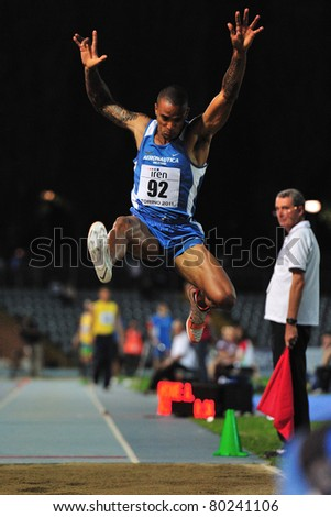 TURIN, ITALY - JUNE 25: HOWE Andrew performs a long jump during the 2011 Summer Track and Field Italian Championship meeting on June 25, 2011 in Turin, Italy. - stock photo
