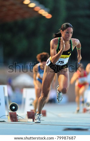 TURIN, ITALY - JUNE 26: Libani Grenot bolts off the start line of the 400m women's sprint race during the 2011 Summer Track and Field Italian Championship meeting on June 26, 2011 in Turin, Italy. - stock photo