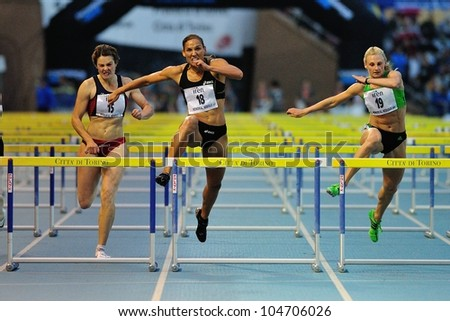 TURIN, ITALY - JUNE 08: Lolo Jones (18) Micol Cattaneo (15) Yuliya Kondakova (15) run 110m HS during the International Track & Field meeting Memorial Nebiolo 2012 on June 08, 2012 in Turin, Italy. - stock photo