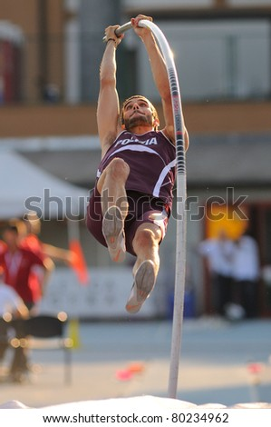 TURIN, ITALY - JUNE 25: PALAZZO Marcello jumps at men's pole vault during the 2011 Summer Track and Field Italian Championship meeting on June 25, 2011 in Turin, Italy. - stock photo