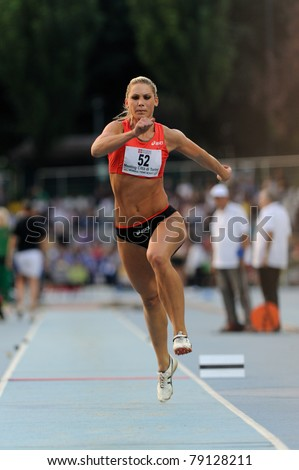TURIN, ITALY - JUNE 10: Rodic Snezana (SLO) performs triple jump during the 2011 Memorial Primo Nebiolo track and field athletics international meeting, on June 10, 2011 in Turin, Italy. - stock photo