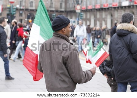 TURIN, ITALY - MAR 17: Crowds pour into the streets in the main square x to celebrate the 150th anniversary of Italian unification in the city (Turin was the first italian capital) on March 17, 2011 in Turin Italy - stock photo