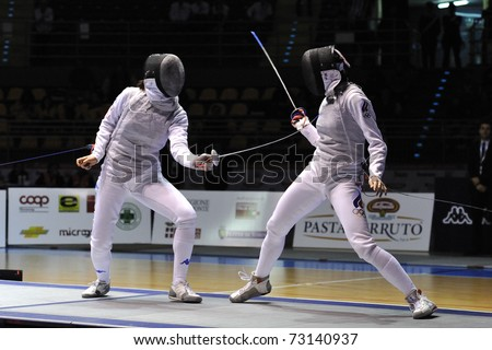 TURIN, ITALY - MARCH 13: Arianna ERRIGO (ITA) fight against SHANAEVA Aida (RUS) during team tournament final match of the 2011 Women world fencing cup on March 13, 2011 in Turin, Italy - stock photo