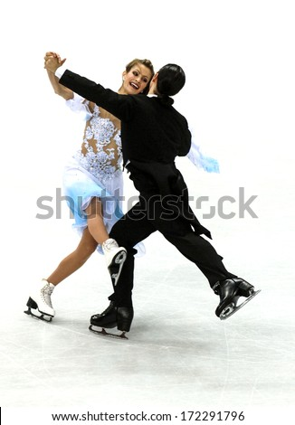 TURIN, ITALY - MARCH 29: Couple dancing during Figure Ice Skating competition of the  Winter Olympic Games in Turin, March, 29 2006.  - stock photo