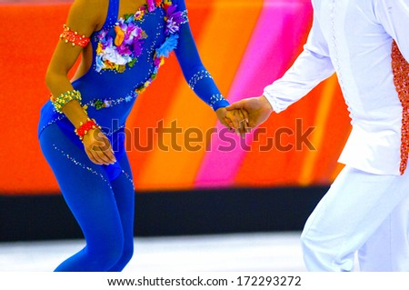 TURIN, ITALY - MARCH 28: Couple dancing during Figure Ice Skating competition of the  Winter Olympic Games in Turin, March 28, 2006.  - stock photo