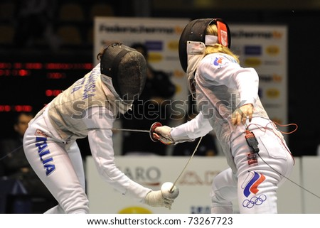 TURIN, ITALY - MARCH 13: Elisa DI FRANCISCA (ITA) fight against Aida SHANAEVA (RUS) during team tournament final match of the 2011 Women world fencing cup on March 13, 2011 in Turin, Italy - stock photo