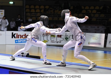 TURIN, ITALY - MARCH 13: Elisa DI FRANCISCA (ITA) fight against Larisa KONOBEINIKOVA (RUS) during team tournament final match of the 2011 Women world fencing cup on March 13, 2011 in Turin, Italy - stock photo