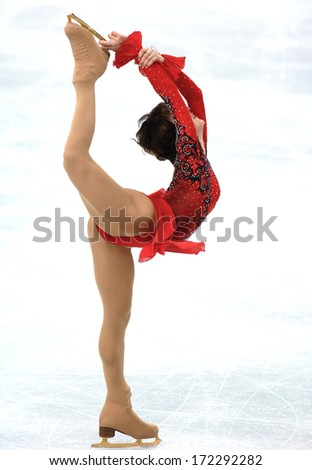 TURIN, ITALY - MARCH 28: ice skater dancing during Female Figure Ice Skating competition of the  Winter Olympic Games in Turin, March 28, 2006.  - stock photo