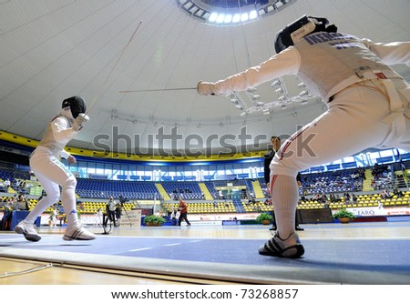 TURIN, ITALY - MARCH 13: IKEHATA Kanae (JAP) fight during team tournament final match of the 2011 Women world fencing cup on March 13, 2011 in Turin, Italy - stock photo