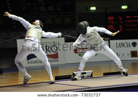 TURIN, ITALY - MARCH 12: Italian fencer Valentina VEZZALI fight against Elisa DI FRANCISCA during the 2011 Women world fencing cup on March 12, 2011 in Turin, Italy - stock photo