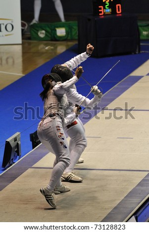 TURIN, ITALY - MARCH 13: NAM Hyun Hee (KOR) fight against RYBICKA Anna (POL) during team tournament semifinal match of the 2011 Women world fencing cup on March 13, 2011 in Turin, Italy - stock photo
