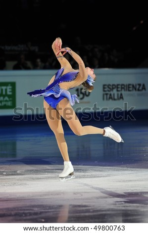TURIN, ITALY - MARCH 28: Professional skater Carolina KOSTNER performs final Gala during the 2010 World Figure Skating Championship on March 28, 2010 in Turin, Italy.
