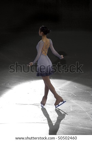 TURIN, ITALY - MARCH 28: Professional skater Yu-Na KIM from South Korea performs free skating during the 2010 World Figure Skating Championship Gala on March 28, 2010 in Turin, Italy. - stock photo