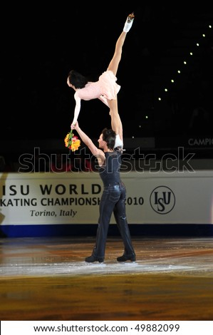 TURIN, ITALY - MARCH 28: Professional skaters Yuko KAVAGUTI & Alexander SMIRNOV perform final Gala during the 2010 World Figure Skating Championship on March 28, 2010 in Turin, Italy. - stock photo