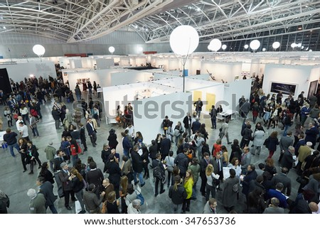 TURIN, ITALY - NOVEMBER 6: Artissima, contemporary art fair opening with people, galleries and art collectors on November 6, 2015 in Turin, Italy. Crowd seen from above attending the art fair opening. - stock photo