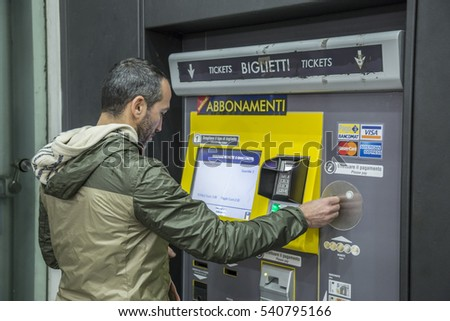 TURIN, ITALY - 01 OCTOBER 2016: beautiful handsome man buying subway ticket at station machine.