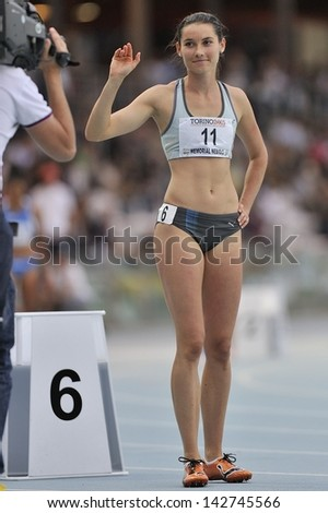 TURIN - JUNE 8: Bartonickova Jitkta from Czechoslovakia cheers at 400m start race at XIX Turin International Track and Field meeting, Italy on 8th june 2013, in Turin, Italy. - stock photo