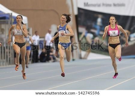 TURIN - JUNE 8:(from left) Bartonickova Jitkta, Chiara Bazzoni and Usovich Ilona run 400m start race at XIX Turin Track and Field meeting, Italy on 8th june 2013, in Turin, Italy. - stock photo