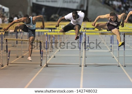 TURIN - JUNE 8: (from left) Bascou Dimitri, Robles Dayron, Abate Emanuele run 110m hurdles man race at XIX Turin International Track and Field meeting, Italy on 8th june 2013, in Turin, Italy. - stock photo