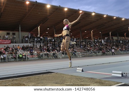 TURIN - JUNE 8:Klishina Darya from Russia performs long jump woman at XIX Turin International Track and Field meeting, Italy on 8th june 2013, in Turin, Italy. - stock photo