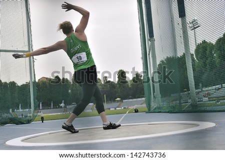 TURIN - JUNE 8:Pedersen Karolina from Swerige performs Hammer Throw at XIX Turin International Track and Field meeting in Turin, Italy on 8th june 2013, in Turin, Italy. - stock photo