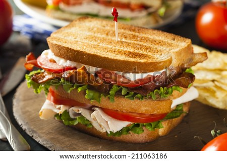 Turkey and Bacon Club Sandwich with Lettuce and Tomato - stock photo