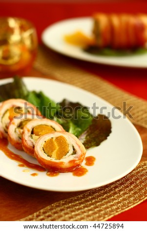 Turkey breast rolls (roulades) with abricot wrapped in bacon