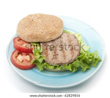 Turkey burger on a whole wheat bun - stock photo