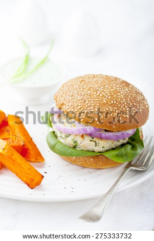 Turkey burger with spinach,onion with roasted sweet potato, batat on a white background - stock photo