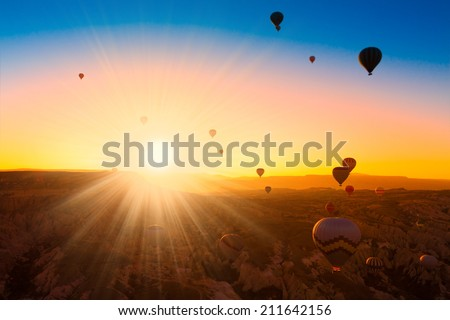 Turkey Cappadocia beautiful balloons flight stone landscape - stock photo