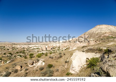 Turkey, Cappadocia. Mountain landscape in the vicinity of Cavusin stone outcrops (weathering posts) - stock photo